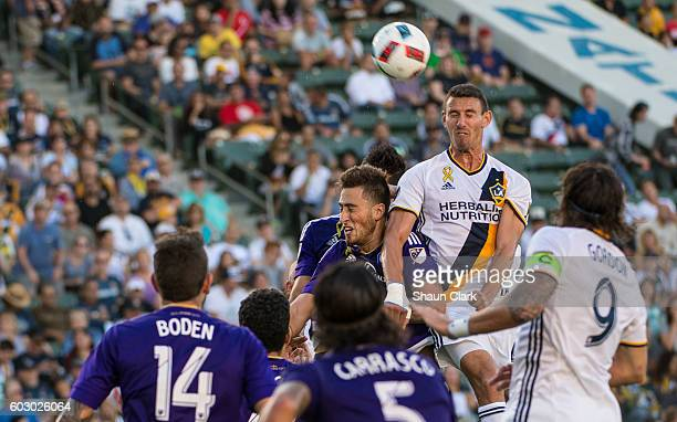 Daniel Steres of Los Angeles Galaxy heads the ball toward goal during Los Angeles Galaxy's MLS match against Orlando City SC at the StubHub Center on...