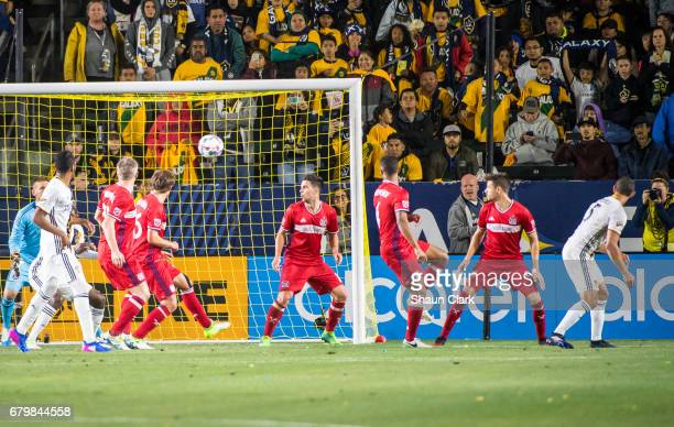 Daniel Steres of Los Angeles Galaxy scores a header during Los Angeles Galaxy's MLS match against Chicago Fire at the StubHub Center on May 6 2017 in...