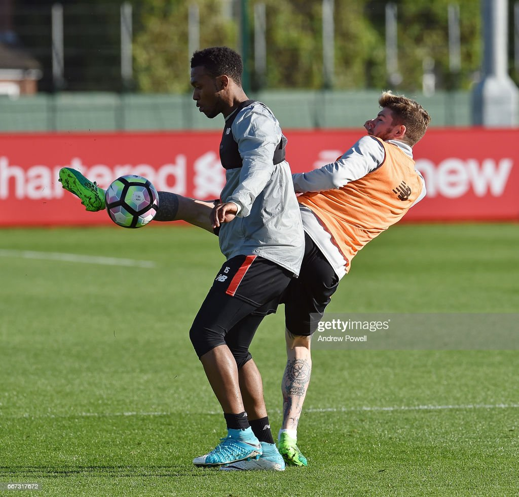 Daniel Sturrdge and Alberto Moreno of Liverpool during a training session at Melwood Training Ground on April 11, 2017 in Liverpool, England.