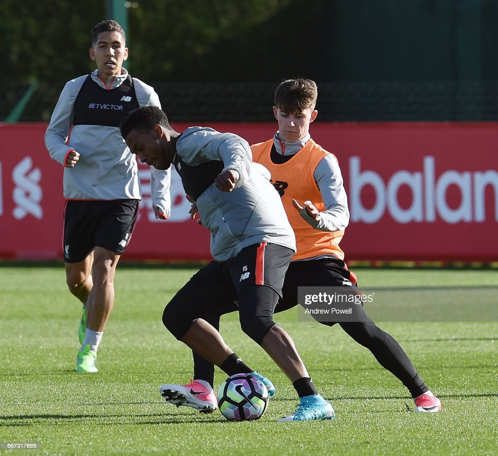 Daniel Sturrdge and Ben Woodburn of Liverpool during a training session at Melwood Training Ground on April 11, 2017 in Liverpool, England.