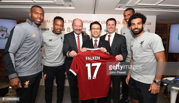 Daniel Sturrdge Nathaniel Clyne Joel Matip and Mohamed Salah of Liverpool look on as Peter Moore CEO of Liverpool and Billy Hogan Cheif Comercial...