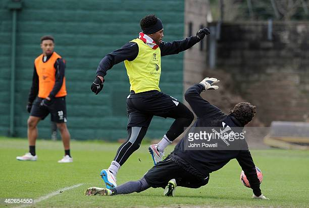 Daniel Sturridge and Danny Ward of Liverpool during a training session at Melwood Training Ground on February 2 2015 in Liverpool England