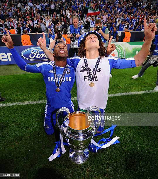 Daniel Sturridge and David Luiz of Chelsea celebrate with the trophy after their victory in the UEFA Champions League Final between FC Bayern...