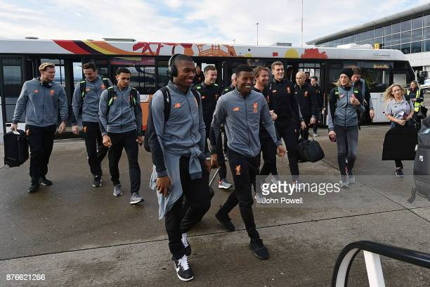 Daniel Sturridge and Georginio Wijnaldum of Liverpool before departing for the group E Champions League match between Sevilla and Liverpool at...