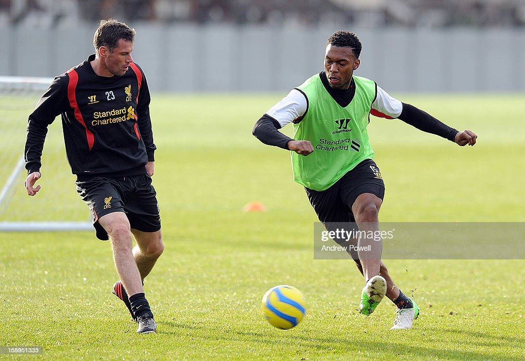 <a gi-track='captionPersonalityLinkClicked' href=/galleries/search?phrase=Daniel+Sturridge+-+Soccer+Player&family=editorial&specificpeople=677270 ng-click='$event.stopPropagation()'>Daniel Sturridge</a> and <a gi-track='captionPersonalityLinkClicked' href=/galleries/search?phrase=Jamie+Carragher&family=editorial&specificpeople=206485 ng-click='$event.stopPropagation()'>Jamie Carragher</a> of Liverpool in action during a training session at Melwood Training Ground on January 4, 2013 in Liverpool, England.
