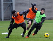 Daniel Sturridge and Joao Carlos Teixeira of Liverpool in action during a training session at Melwood Training Ground on January 31 2014 in Liverpool...