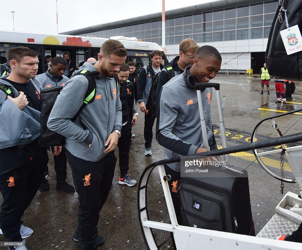 Daniel Sturridge and Jordan Henderson of Liverpool boarding the plane at John Lennon Airport on September 25, 2017 in Liverpool, England.