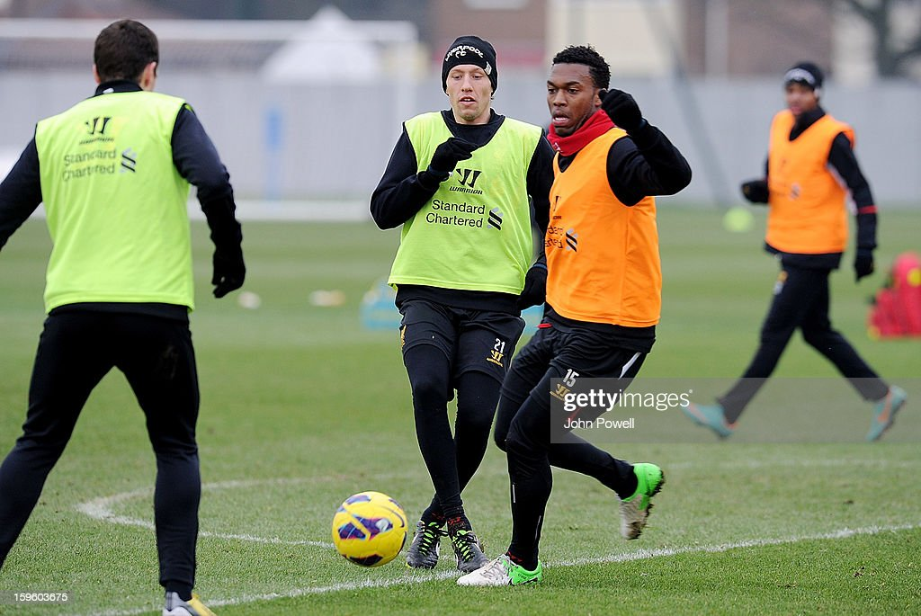 Daniel Sturridge and Lucas Leiva of Liverpool in action during a training session at Melwood Training Ground on January 17, 2013 in Liverpool, England.