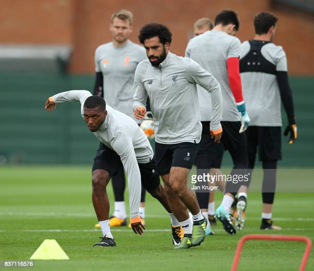 Daniel Sturridge and Mohamed Salah take part in the Liverpool Training Session at Melwood on August 22 2017 in Liverpool England The second leg of...