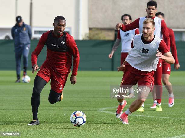 Daniel Sturridge and Ragnar Klavan of Liverpool during a training session at Melwood Training Ground on September 14 2017 in Liverpool United Kingdom