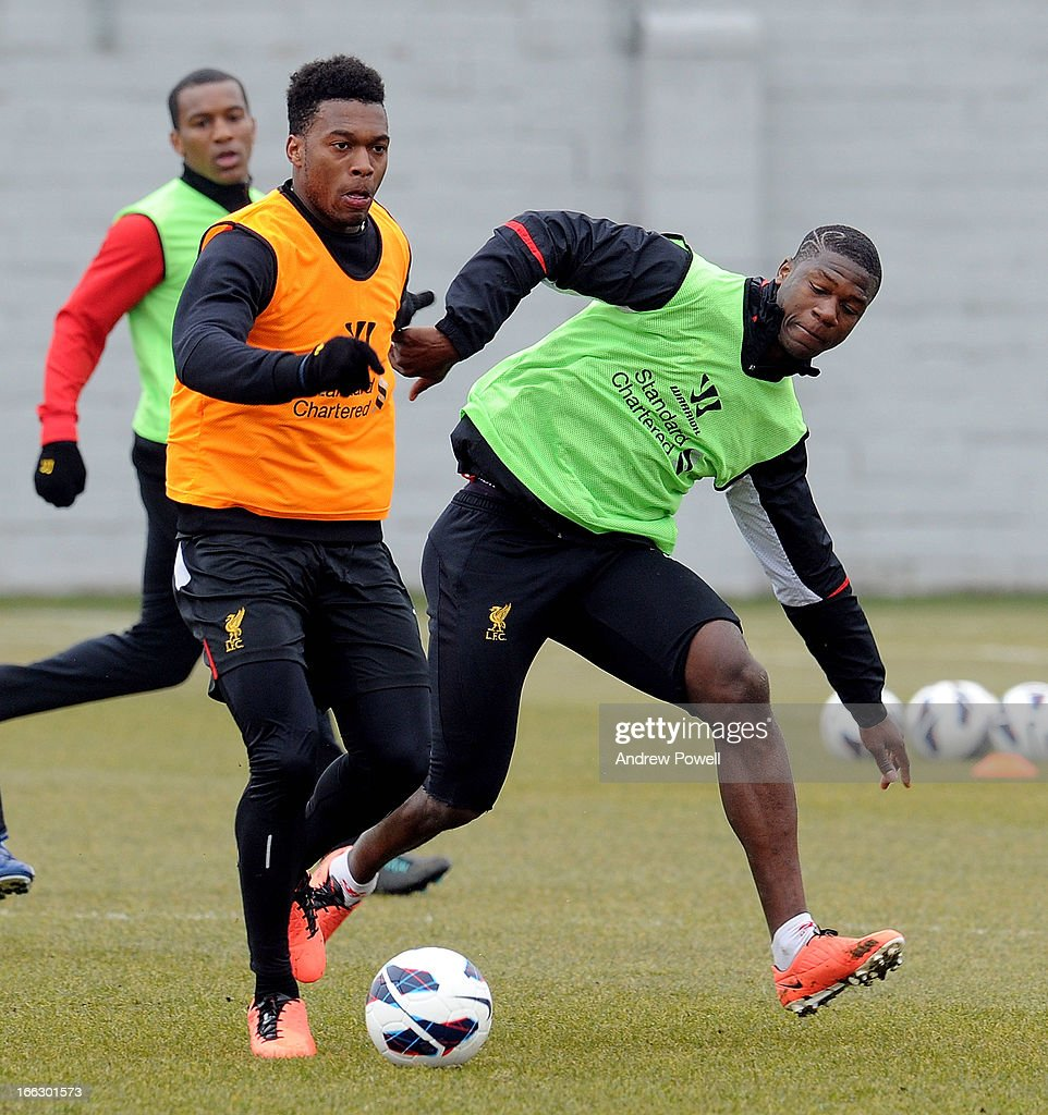 Daniel Sturridge and Stephen Sama of Liverpool in action during a training session at Melwood Training Ground on April 11, 2013 in Liverpool, England.