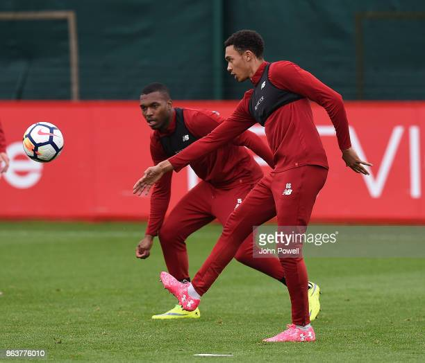 Daniel Sturridge and Trent AlexanderArnold of Liverpool during a training session at Melwood Training Ground on October 20 2017 in Liverpool England