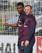 Daniel Sturridge and Wayne Rooney look on during the England training session at St Georges Park on September 5 2014 in BurtonuponTrent England