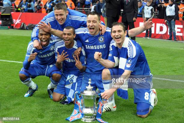 Daniel Sturridge Gary Cahill Ashley Cole John Terry and Frank Lampard of Chelsea celebrate with the FA Cup after their victory over Liverpool at...