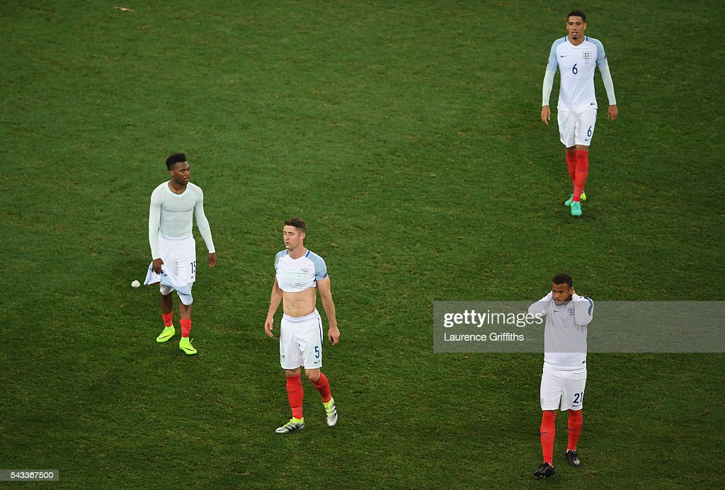 <a gi-track='captionPersonalityLinkClicked' href=/galleries/search?phrase=Daniel+Sturridge+-+Soccer+Player&family=editorial&specificpeople=677270 ng-click='$event.stopPropagation()'>Daniel Sturridge</a>, <a gi-track='captionPersonalityLinkClicked' href=/galleries/search?phrase=Gary+Cahill&family=editorial&specificpeople=204341 ng-click='$event.stopPropagation()'>Gary Cahill</a>, <a gi-track='captionPersonalityLinkClicked' href=/galleries/search?phrase=Chris+Smalling&family=editorial&specificpeople=5964313 ng-click='$event.stopPropagation()'>Chris Smalling</a> and <a gi-track='captionPersonalityLinkClicked' href=/galleries/search?phrase=Ryan+Bertrand+-+Soccer+Player&family=editorial&specificpeople=1820135 ng-click='$event.stopPropagation()'>Ryan Bertrand</a> of England show their dejection after their defeat in the UEFA EURO 2016 round of 16 match between England and Iceland at Allianz Riviera Stadium on June 27, 2016 in Nice, France.