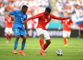 Daniel Sturridge in action with Marvin Chavez of Honduras during the International Friendly match between England and Honduras at Sun Life Stadium on...