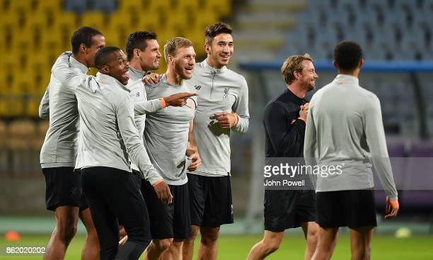Daniel Sturridge Joel Matip Dejan Lovren Ragnar Klavan and Marko Grujic of Liverpool during a training session at Stadion Ljudski vrt on October 16...