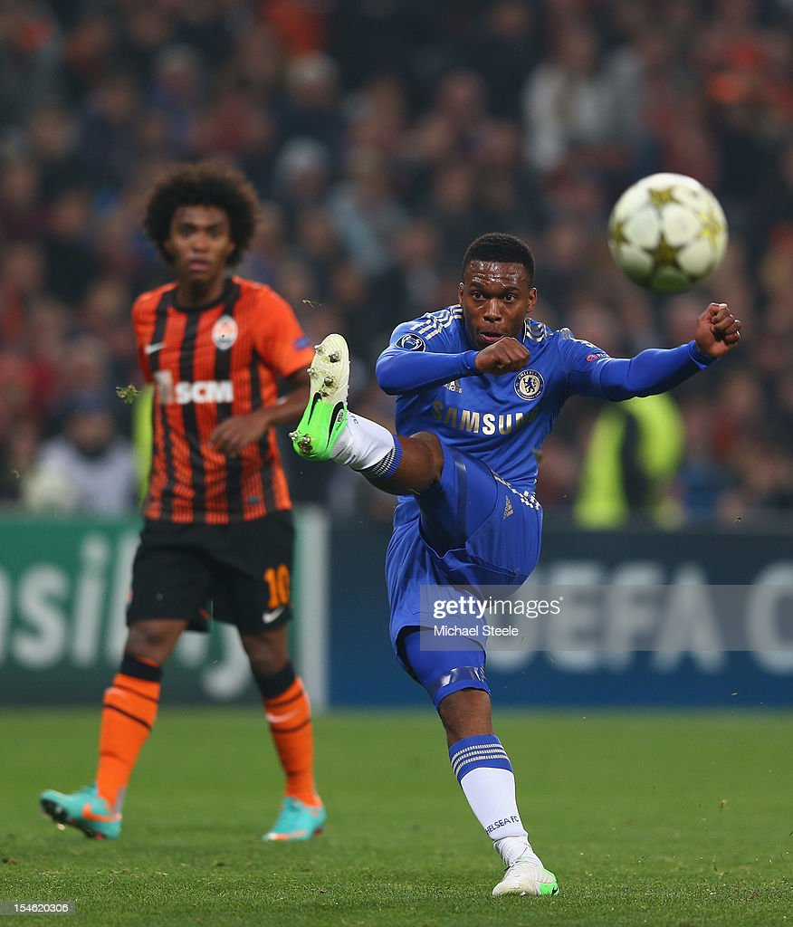 Daniel Sturridge (R) of Chelsea shoots during the UEFA Champions League Group E match between Shakhtar Donetsk and Chelsea at the Donbass Arena on October 23, 2012 in Donetsk, Ukraine.