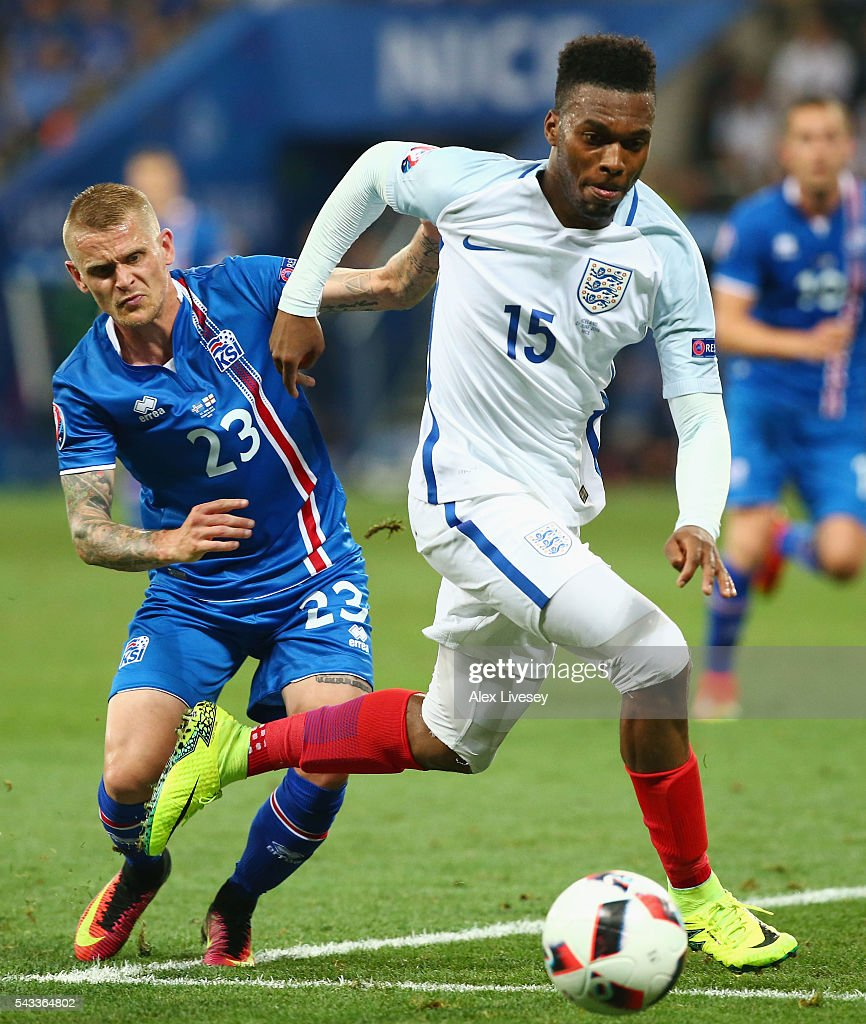 <a gi-track='captionPersonalityLinkClicked' href=/galleries/search?phrase=Daniel+Sturridge+-+Soccer+Player&family=editorial&specificpeople=677270 ng-click='$event.stopPropagation()'>Daniel Sturridge</a> of England and Ari Skulason of Iceland compete for the ball during the UEFA EURO 2016 round of 16 match between England and Iceland at Allianz Riviera Stadium on June 27, 2016 in Nice, France.