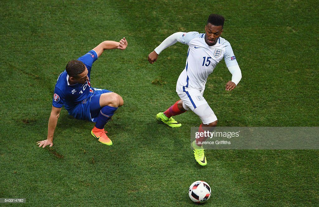 <a gi-track='captionPersonalityLinkClicked' href=/galleries/search?phrase=Daniel+Sturridge+-+Soccer+Player&family=editorial&specificpeople=677270 ng-click='$event.stopPropagation()'>Daniel Sturridge</a> of England and <a gi-track='captionPersonalityLinkClicked' href=/galleries/search?phrase=Gylfi+Sigurdsson&family=editorial&specificpeople=6401581 ng-click='$event.stopPropagation()'>Gylfi Sigurdsson</a> of Iceland compete for the ball during the UEFA EURO 2016 round of 16 match between England and Iceland at Allianz Riviera Stadium on June 27, 2016 in Nice, France.