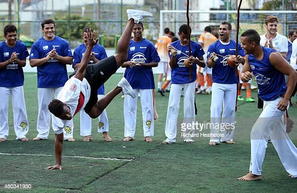 Daniel Sturridge of England attempts Capoeira during a visit to Complexo Esportivo da Rocinha on June 9 2014 in Rio de Janeiro Brazil