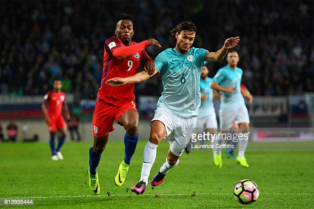 Daniel Sturridge of England battles for the ball with Rene Krhin of Slovenia during the FIFA 2018 World Cup Qualifier Group F match between Slovenia...