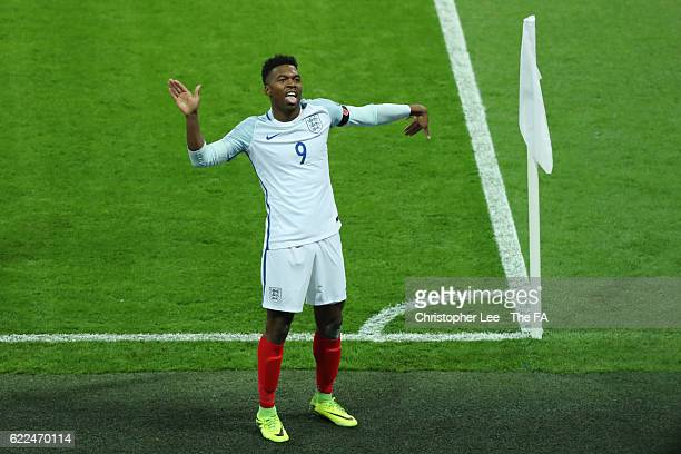 Daniel Sturridge of England celebrates scoring the opening goal during the FIFA 2018 World Cup Qualifier between England and Scotland at Wembley...
