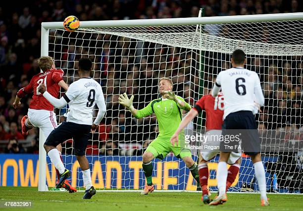 Daniel Sturridge of England heads in the first goal past Kasper Schmeichel of Denmark during the International Friendly match between England and...