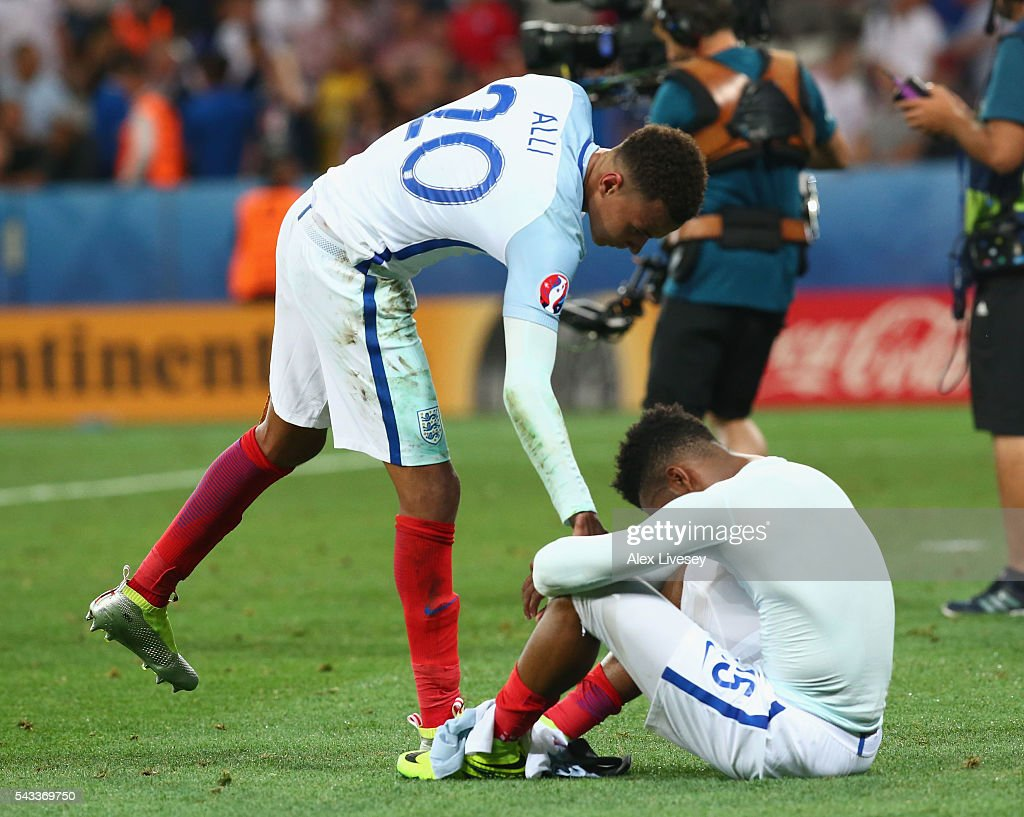 <a gi-track='captionPersonalityLinkClicked' href=/galleries/search?phrase=Daniel+Sturridge+-+Soccer+Player&family=editorial&specificpeople=677270 ng-click='$event.stopPropagation()'>Daniel Sturridge</a> (R) of England is consoled by <a gi-track='captionPersonalityLinkClicked' href=/galleries/search?phrase=Dele+Alli&family=editorial&specificpeople=9976958 ng-click='$event.stopPropagation()'>Dele Alli</a> (L) after their defeat in the UEFA EURO 2016 round of 16 match between England and Iceland at Allianz Riviera Stadium on June 27, 2016 in Nice, France.