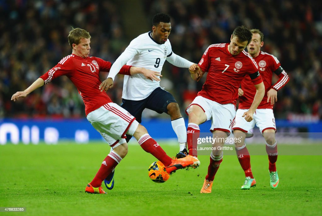<a gi-track='captionPersonalityLinkClicked' href=/galleries/search?phrase=Daniel+Sturridge+-+Soccer+Player&family=editorial&specificpeople=677270 ng-click='$event.stopPropagation()'>Daniel Sturridge</a> of England is tackled by <a gi-track='captionPersonalityLinkClicked' href=/galleries/search?phrase=Jesper+Juelsgard&family=editorial&specificpeople=9171946 ng-click='$event.stopPropagation()'>Jesper Juelsgard</a> (L) and <a gi-track='captionPersonalityLinkClicked' href=/galleries/search?phrase=William+Kvist&family=editorial&specificpeople=2465270 ng-click='$event.stopPropagation()'>William Kvist</a> of Denmark during the International Friendly match between England and Denmark at Wembley Stadium on March 5, 2014 in London, England.