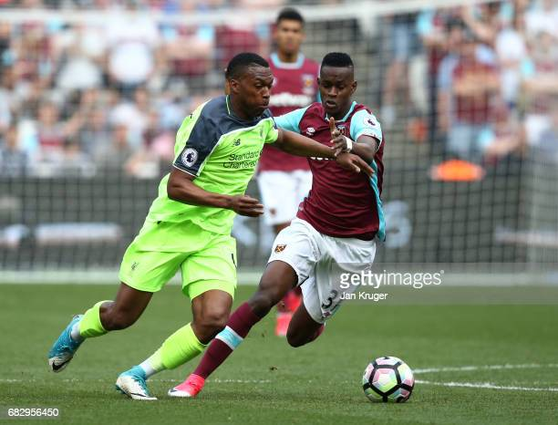 Daniel Sturridge of Liverpool and Edimilson Fernandes of West Ham United battle for possession during the Premier League match between West Ham...