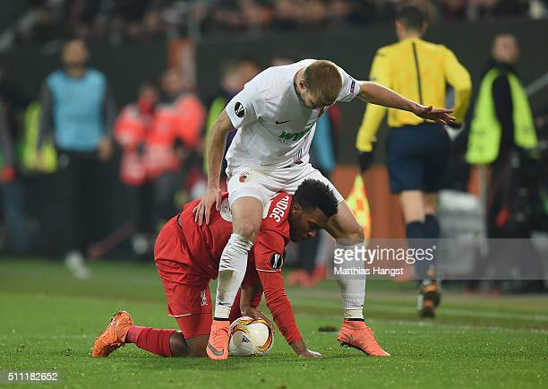 Daniel Sturridge of Liverpool and Ragnar Klavan of Augsburg compete for the ball during the UEFA Europa League round of 32 first leg match between FC...