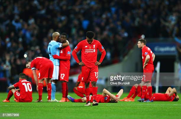 Daniel Sturridge of Liverpool and team mates look dejected in defeat after the Capital One Cup Final match between Liverpool and Manchester City at...
