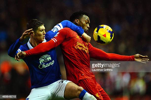 Daniel Sturridge of Liverpool attempts to control the ball under pressure from John Stones of Everton during the Barclays Premier League match...