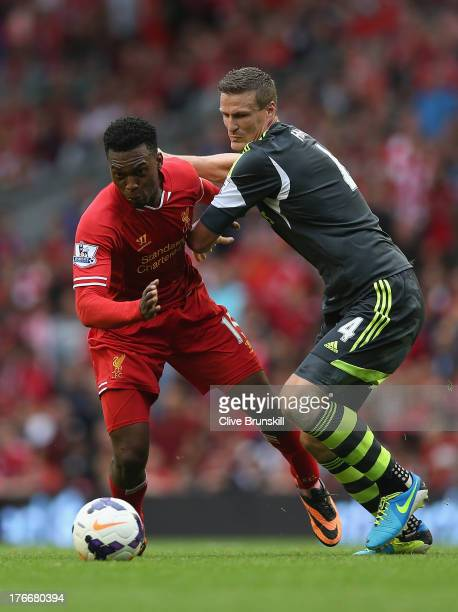 Daniel Sturridge of Liverpool attempts to move away from Robert Huth of Stoke City during the Barclays Premier League match between Liverpool and...