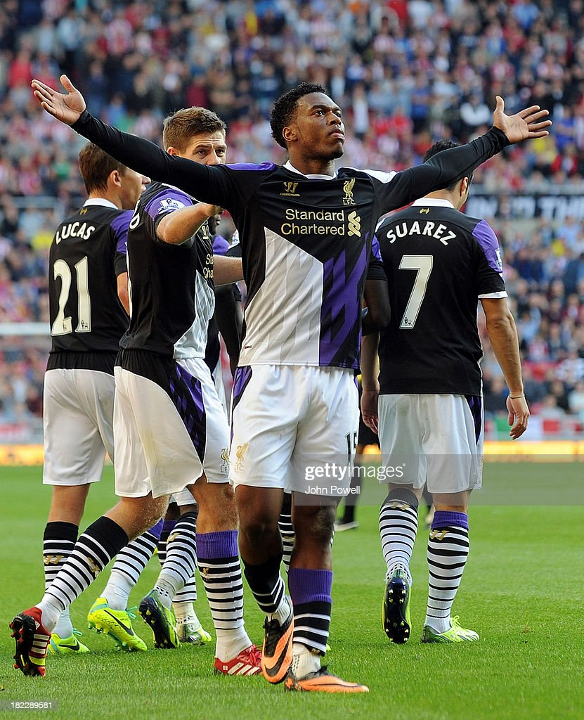<a gi-track='captionPersonalityLinkClicked' href=/galleries/search?phrase=Daniel+Sturridge&family=editorial&specificpeople=677270 ng-click='$event.stopPropagation()'>Daniel Sturridge</a> of Liverpool celebrates after scoing the opening goal during the Barclays Premier League match between Sunderland and Liverpool at Stadium of Light on September 29, 2013 in Sunderland, England.