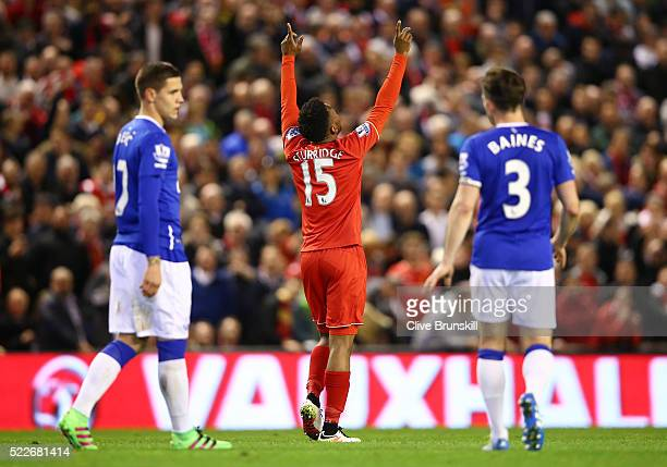 Daniel Sturridge of Liverpool celebrates after scoring his sides third goal during the Barclays Premier League match between Liverpool and Everton at...