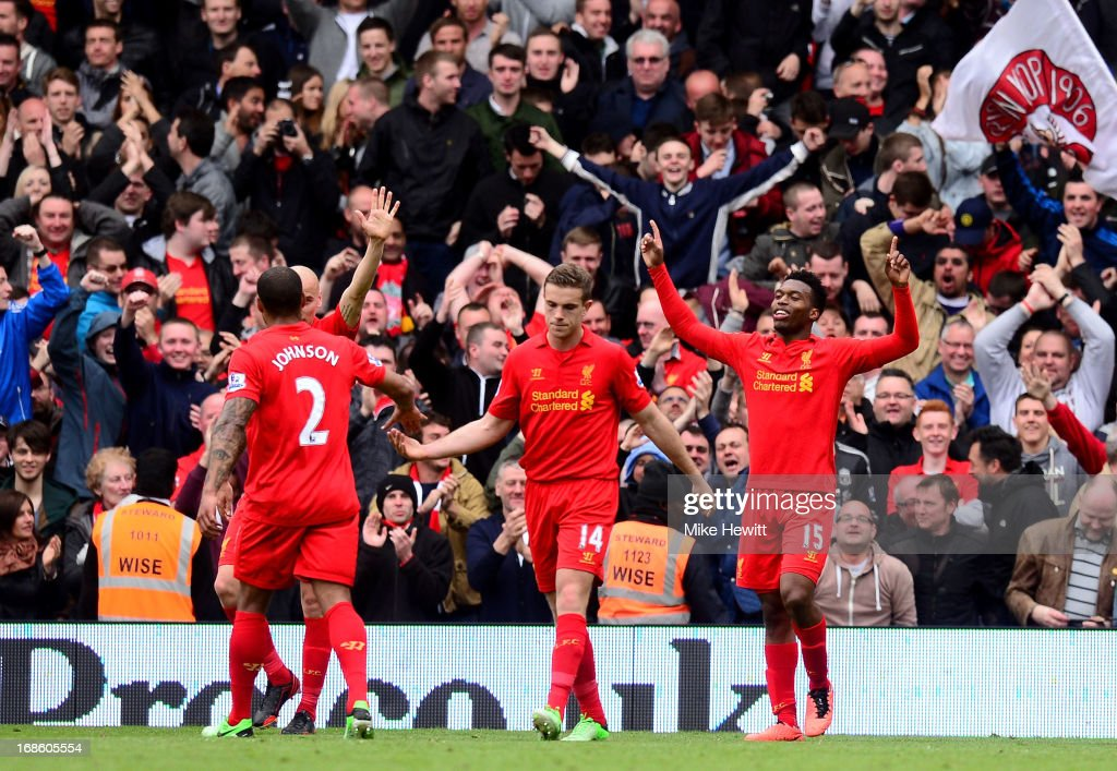 Daniel Sturridge #15 (R) of Liverpool celebrates after scoring his team's second goal during the Barclays Premier League match between Fulham and Liverpool at Craven Cottage on May 12, 2013 in London, England.