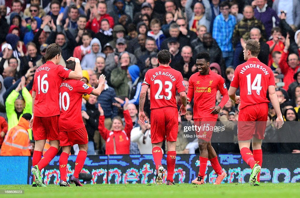Daniel Sturridge #15 (2nd R) of Liverpool celebrates after scoring his team's third goal and cmpleting his hat trick during the Barclays Premier League match between Fulham and Liverpool at Craven Cottage on May 12, 2013 in London, England.