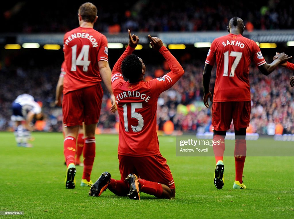 Daniel Sturridge of Liverpool celebrates after scoring his team's fourth goal during the Barclays Premier League match between Liverpool and West Bromwich Albion at Anfield on October 26, 2013 in Liverpool, England.