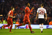 Daniel Sturridge of Liverpool celebrates as he scores their first goal from the penalty spot during the UEFA Europa League Round of 16 first leg...