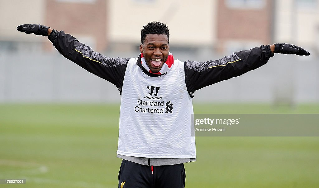 <a gi-track='captionPersonalityLinkClicked' href=/galleries/search?phrase=Daniel+Sturridge&family=editorial&specificpeople=677270 ng-click='$event.stopPropagation()'>Daniel Sturridge</a> of Liverpool celebrates during a training session at Melwood Training Ground on March 14, 2014 in Liverpool, England.