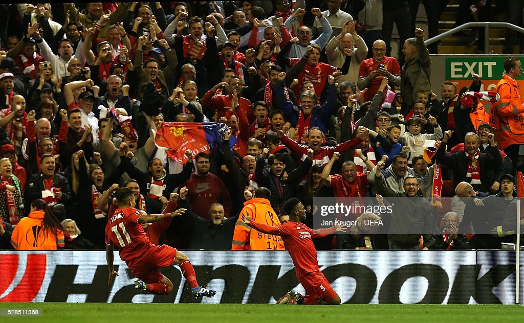 Daniel Sturridge of Liverpool celebrates his sides second goal with team mates during the UEFA Europa League Semi Final second leg match between Liverpool and Villarreal CF at Anfield on May 05, 2016 in Liverpool, England.