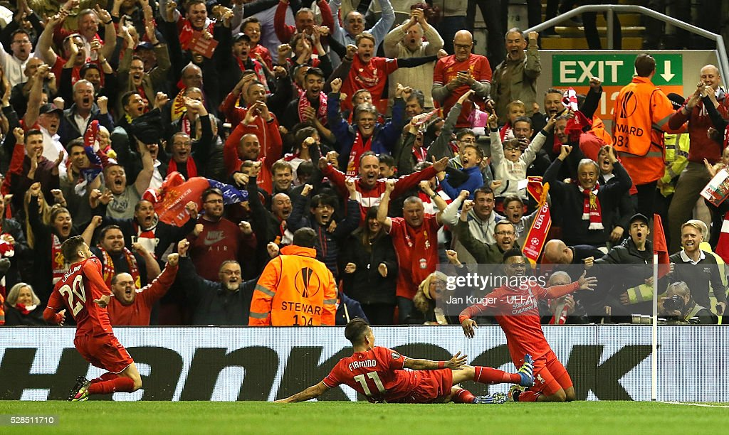 Daniel Sturridge of Liverpool celebrates his sides second goal with team-mates during the UEFA Europa League Semi Final second leg match between Liverpool and Villarreal CF at Anfield on May 05, 2016 in Liverpool, England.