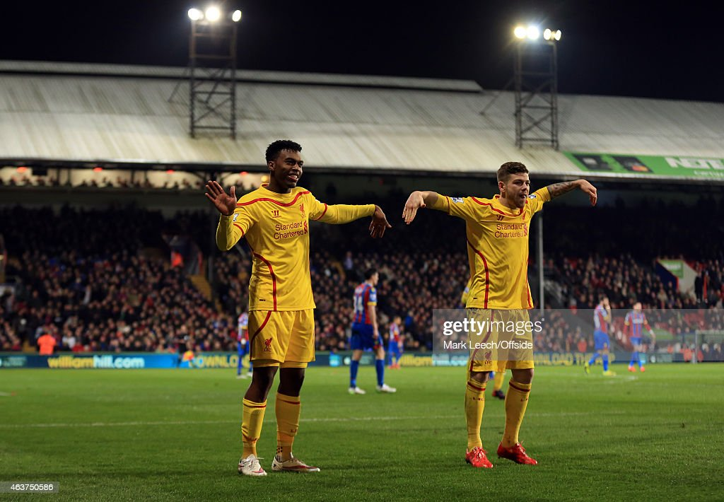 Daniel Sturridge of Liverpool celebrates scoring a goal to make it 1-1 with Alberto Moreno during the FA Cup fifth round match between Crystal Palace and Liverpool at Selhurst Park on February 14, 2015 in London, England.