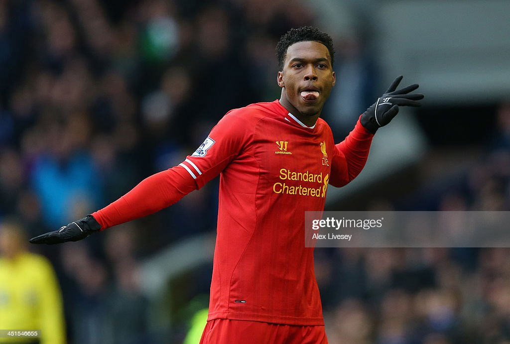 Daniel Sturridge of Liverpool celebrates scoring his team's third goal during the Barclays Premier League match between Everton and Liverpool at Goodison Park on November 23, 2013 in Liverpool, England.