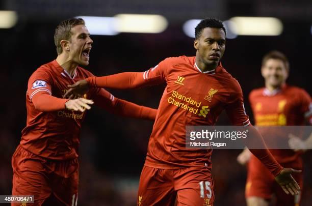 Daniel Sturridge of Liverpool celebrates scoring the second goal with teammate Jordan Henderson during the Barclays Premier League match between...