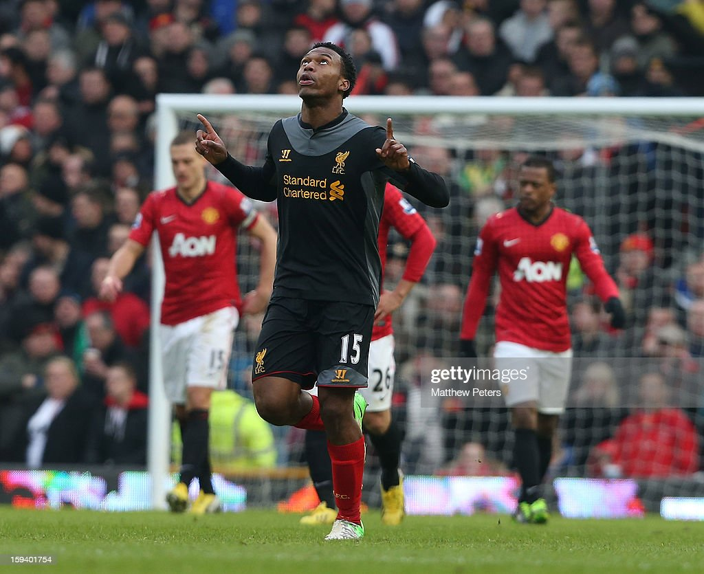 <a gi-track='captionPersonalityLinkClicked' href=/galleries/search?phrase=Daniel+Sturridge+-+Soccer+Player&family=editorial&specificpeople=677270 ng-click='$event.stopPropagation()'>Daniel Sturridge</a> of Liverpool celebrates scoring their first goal during the Barclays Premier League match between Manchester United and Liverpool at Old Trafford on January 13, 2013 in Manchester, England.