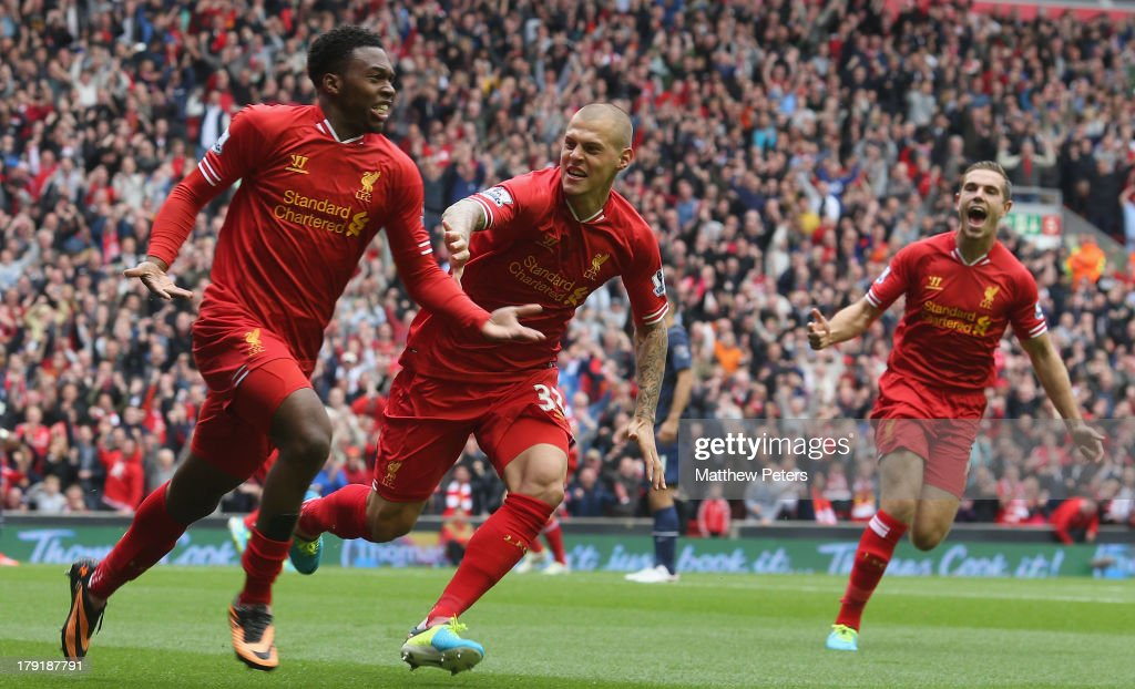 <a gi-track='captionPersonalityLinkClicked' href=/galleries/search?phrase=Daniel+Sturridge+-+Soccer+Player&family=editorial&specificpeople=677270 ng-click='$event.stopPropagation()'>Daniel Sturridge</a> of Liverpool (L) celebrates scoring their first goal with <a gi-track='captionPersonalityLinkClicked' href=/galleries/search?phrase=Martin+Skrtel&family=editorial&specificpeople=5554576 ng-click='$event.stopPropagation()'>Martin Skrtel</a> during the Barclays Premier League match between Liverpool and Manchester United at Anfield on September 01, 2013 in Liverpool, England.