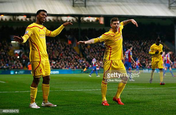 Daniel Sturridge of Liverpool celebrates scoring their first goal with Alberto Moreno of Liverpool during the FA Cup fifth round match between...